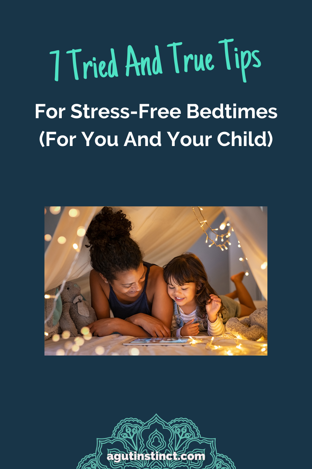 a mother and her daughter lying on their bellies next to each other inside a blanket fort, surrounded by a string of white lights representing a happy and calm bedtime routine for bedtimes without stress or tears or tantrums